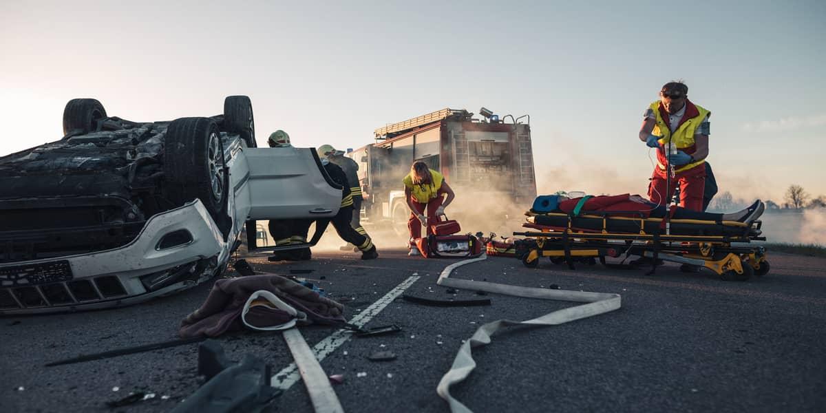 Paramedics at a car crash accident scene